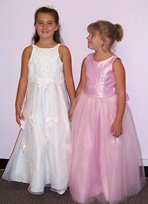 Two girls in flower girl dresses